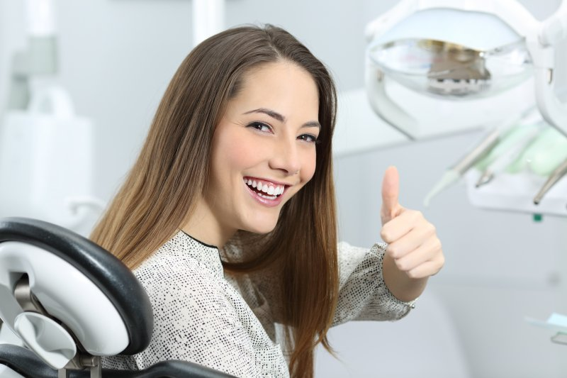 woman smiling sitting dentist chair
